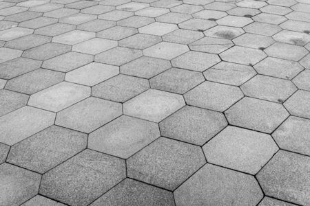 Photo for Top view on paving stone road. Old pavement of granite texture. Street hexagonal cobblestone sidewalk. Abstract background for design. - Royalty Free Image