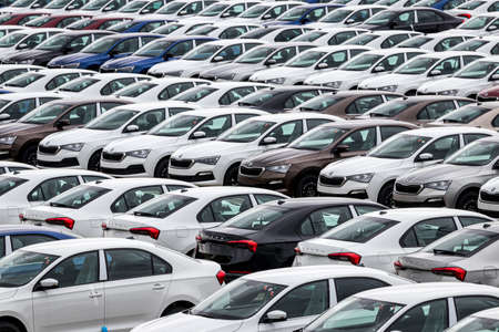Photo pour Volkswagen Group Rus, Russia, Kaluga  - MAY 24, 2020: Rows of a new cars parked in a distribution center on a cloudy day in the spring, a car factory. Parking in the open air. - image libre de droit