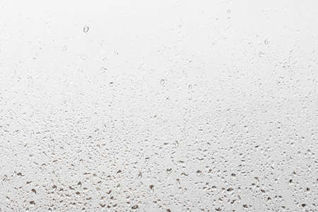 Photo for Rain drops on window glasses surface with gray sky background. Natural backdrop of raindrops. Abstract overlay for design. The concept of bad rainy weather. - Royalty Free Image