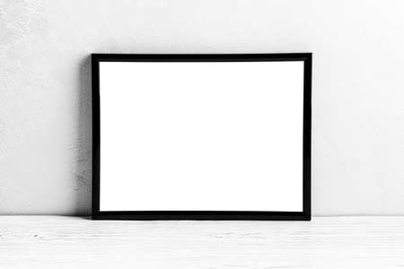Photo for White wooden floor over concrete or decorative plaster wall and black photo frame with copy space for a text background. Mock up for design. - Royalty Free Image