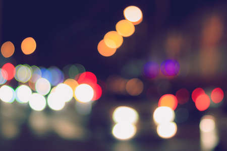 Photo pour Blurred lights of headlights of cars and lanterns in the night city. Abstract bright bokeh. - image libre de droit