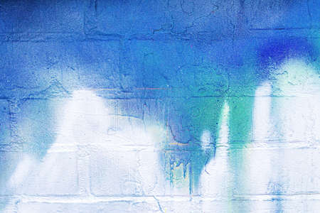 Photo pour A fragment of colorful graffiti painted on a wall. Abstract urban background for design. - image libre de droit