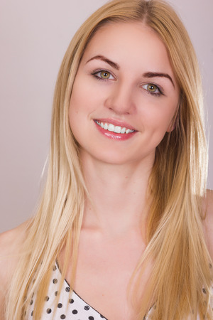 Studio portrait of a beautiful young blonde woman with natural make-up