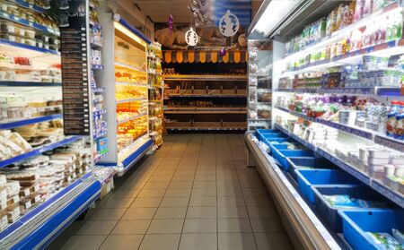 Photo pour Nursultan,Kazakhstan,november.22.19. Food stands in the supermarket.A grocery store with shelves of food.Provisions,dairy products,bread,cheese,yogurt and sweets are on the shelf in the grocery mall - image libre de droit