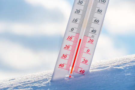Photo for The thermometer lies on the snow in winter showing a negative temperature.Meteorological conditions in a harsh climate in winter with low air and ambient temperatures.Freeze in wintertime.Sunny winter - Royalty Free Image