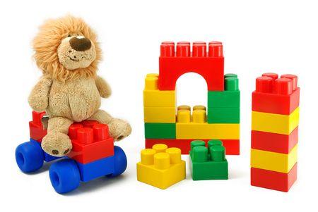 Foto de Toys - the children's blocks and a soft toy it is isolated. - Imagen libre de derechos
