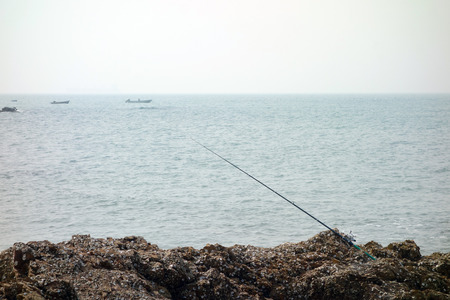 fishing pole at seaside