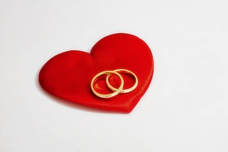 Photo for red hearts and wedding rings on a white background - Royalty Free Image