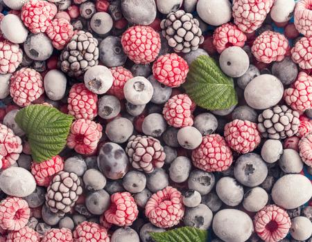 Assorted frozen berries background