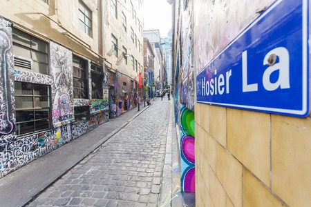 Melbourne, Australia - July 21, 2014: Hosier Lane in Melbourne, Australia. Hosier Lane is a laneway in CBD of Melbourne, It is a popular landmark in Melbourne due to its graffitti covered walls and urban art.