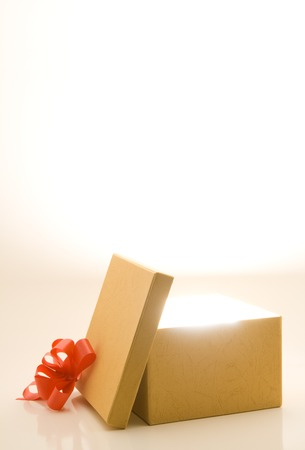 Opened gift box with light and room for text