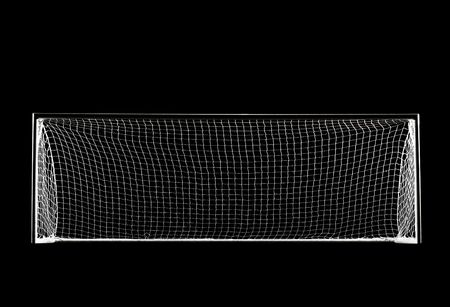 A soccer goal or football goal with a simple black backdrop isolated from the darkness with spotlight lighting
