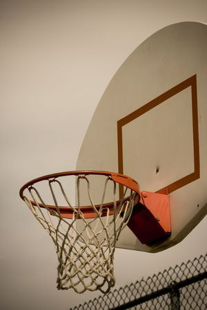 A vertical cross processed basketball hoop background. Lots of Copy space room and cool sepia filter feel.