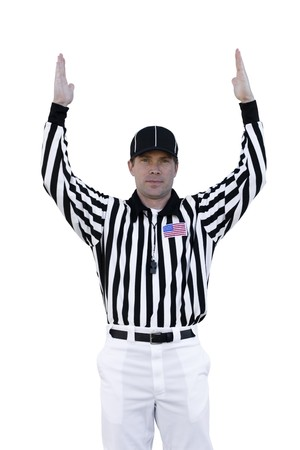 A football referee signals for a touchdown.