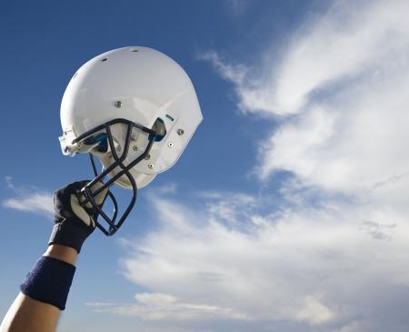 Football Helmet Raised in Victory