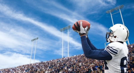 Photo for Football Player catching a touchdown pass - Royalty Free Image