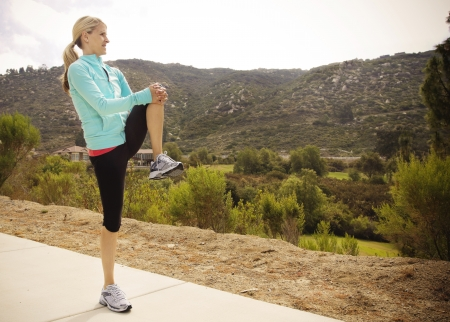 Attractive Female Runner Stretching before Workout