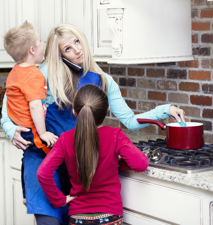 Photo for Overwhelmed and frustrated Mom in the kitchen - Royalty Free Image