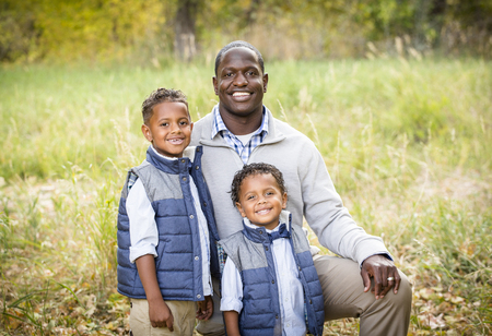 Outdoor Portrait of a Racially Diverse Father with his two sons