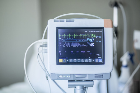 Photo for Medical vital signs monitor instrument in a hospital. This health care device displays and monitors heart rate and oxygen levels in hospital patients - Royalty Free Image