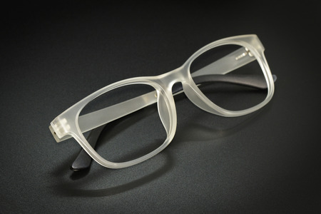 Image of modern fashionable spectacles isolated on black background, Eyewear, Glasses