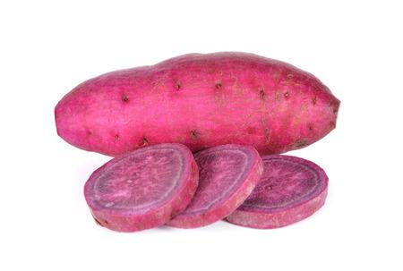 whole and sliced sweet potato on white background