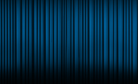 Blue curtain with spot light on theater or cinema stage.