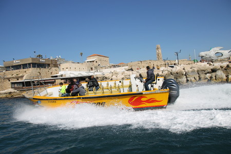 Speed boat by ancient port