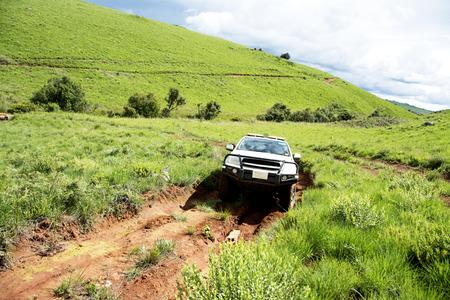 4x4 Vehicle Traveling on Dangerous Dirt Road in Nyika Plateau, Malawi, Africa