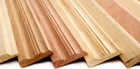 Photo pour Combination of Wooden Skirting boards over white - image libre de droit