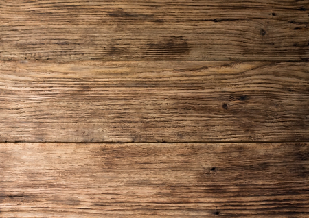 Photo of old worn wooden board with interesting texture of wood material
