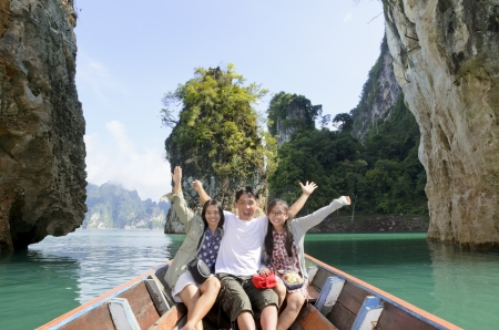 Happy family boat trip on summer vacation in Ratchaprapha Dam, Khao Sok National Park, Surat Thani Province, Thailand   Guilin of Thailand