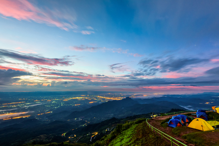 Photo pour High view beautiful nature landscape of colorful sky during the sunrise, see the lights of the road and city from the campsite at Phu Thap Berk viewpoint, Phetchabun Province, Thailand - image libre de droit