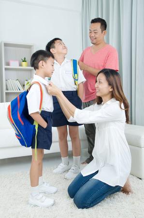Asian parents get their children ready to school