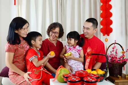 Photo pour Asian family celebrate chinese new year.Chinese characters in the photo means - image libre de droit