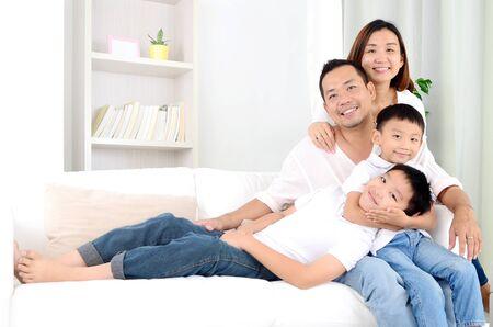 Foto de happy asian family parent spending time with their children during coronavirus pandemic time. - Imagen libre de derechos