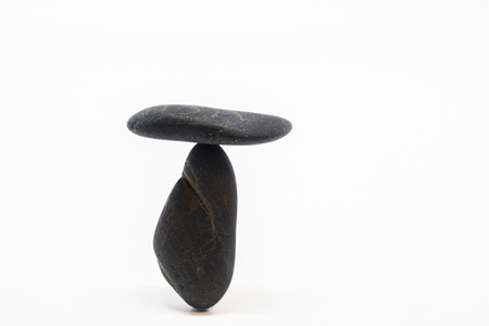 Balance concept, different stones are located together on a white background.