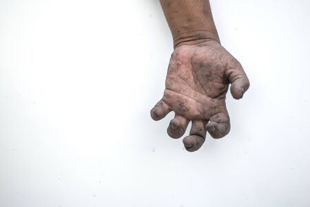 Photo pour The dirty man's hand shows a meaningful gesture. - image libre de droit