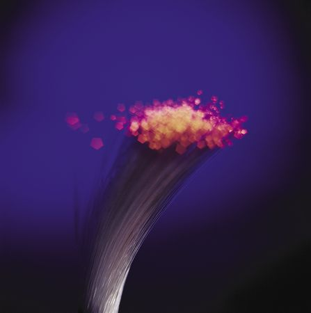Closeup detail of a fiber optic bundle with glowing red tips.