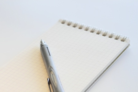 closeup white note and pen on white background