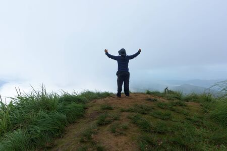 Photo for Man traveler on cliff with beautiful foggy in national park. - Royalty Free Image