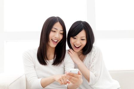 Beautiful young women using a moblie phone  Portrait of asian women