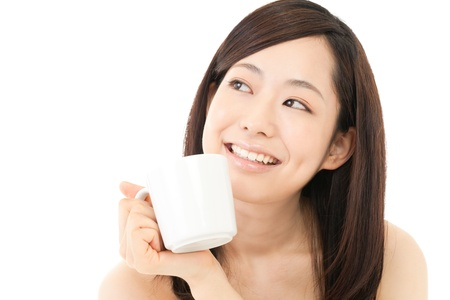 Beautiful young woman drinking coffee  Portrait of asian  の写真素材
