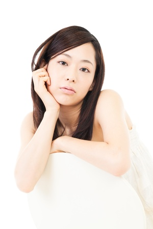 Beautiful young woman relaxing on white backgroundの写真素材