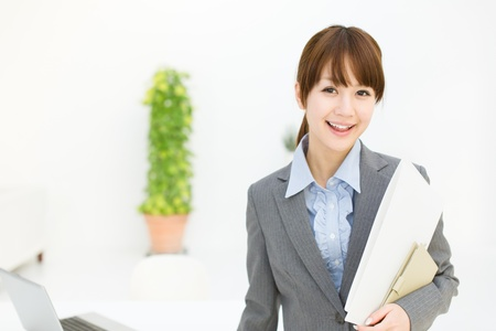 Beautiful young businesswoman working in office の写真素材