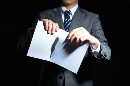 Businessman tear paper concept for breaking contractの写真素材