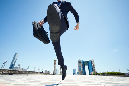 Photo pour business man jumping on the road - image libre de droit