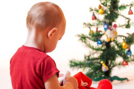 Photo pour Portrait of a little boy near a New Year tree - image libre de droit