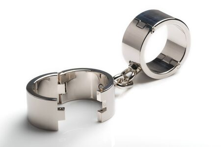 Photo pour Beautiful metal iron chrome handcuffs - image libre de droit