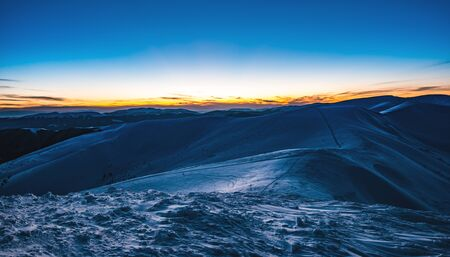 Photo pour Stunning beautiful views of the slopes in the ski resort after sunset in the late evening. The concept of vacation in the northern country on holidays and New Year holidays - image libre de droit